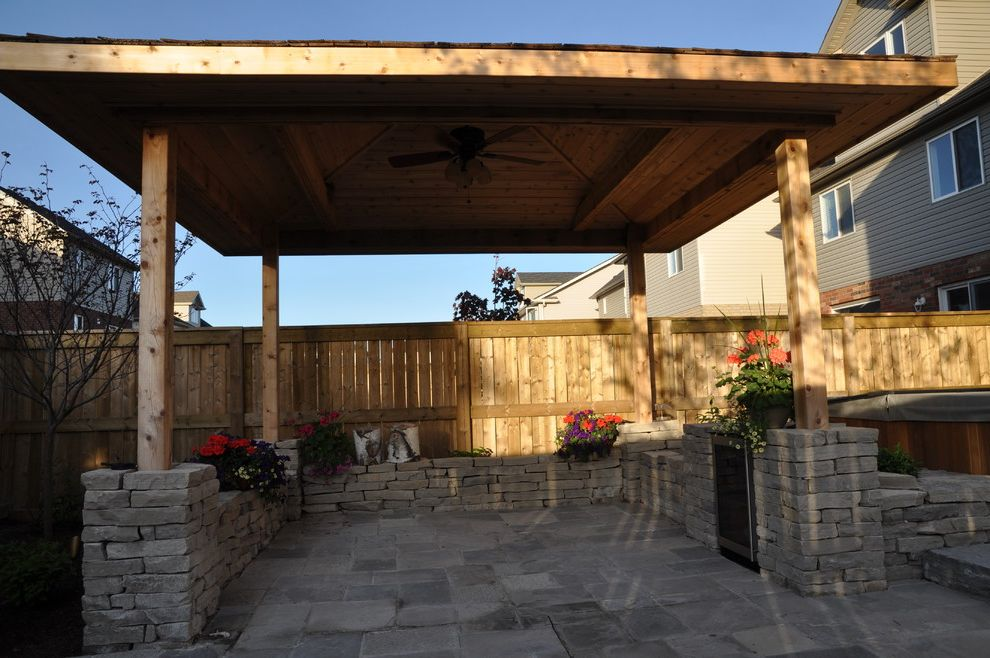Landscapers depot with traditional landscape and covered patio