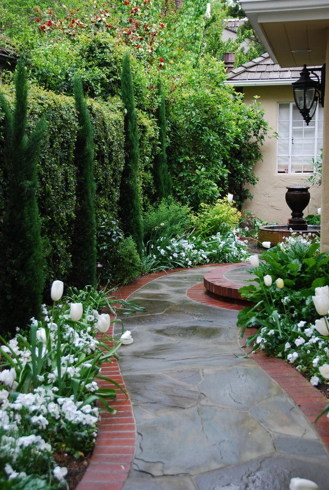 Landscapers Near Me   Traditional Landscape  and Bluestone Brick Edging Cypress Flagstone Hedge Path Side Yard Tulips Walkway