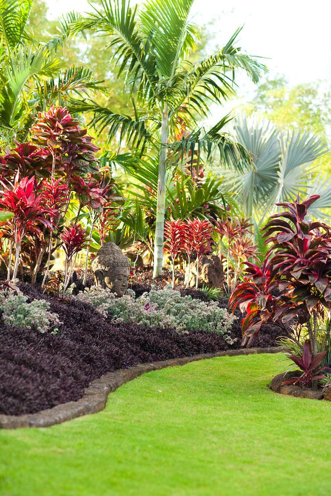 Landscaping Bismarck Nd   Tropical Landscape  and Asian Statue Buddha Bushes Edging Grass Ground Cover Lawn Palm Palm Tree Red Bushes Red Flowers Shrubs Stone Statue Trees