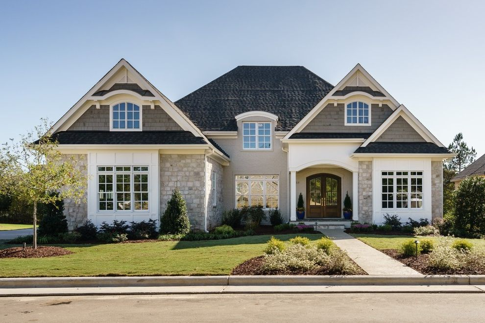 Landscaping Cary Nc   Traditional Exterior Also Arched Entry Bay Window Curb Appeal Grass Landscaping Neutral Segment Top Windows Shingle Siding Stone