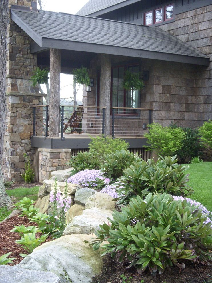 Landscaping Cary Nc with Rustic Porch Also Bark Shingles Cable Railing Covered Porch Landscaping Lap Siding Lawn Plant Urns Red Flowers Rustic Seating Area Stained Wood Stone Work Walkway Wood Deck Wood Front Door Wood Trim