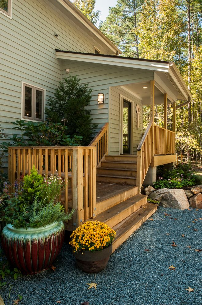 Landscaping Cary Nc with Traditional Deck Also Covered Porch Gravel Landscape Gray Exterior Gray Siding Orange Flowers Outdoor Potted Plant Rock Landscape Rocks Wood Beam Wood Deck Wood Deck Railing Wood Deck Stairs Wood Post Wood Railing
