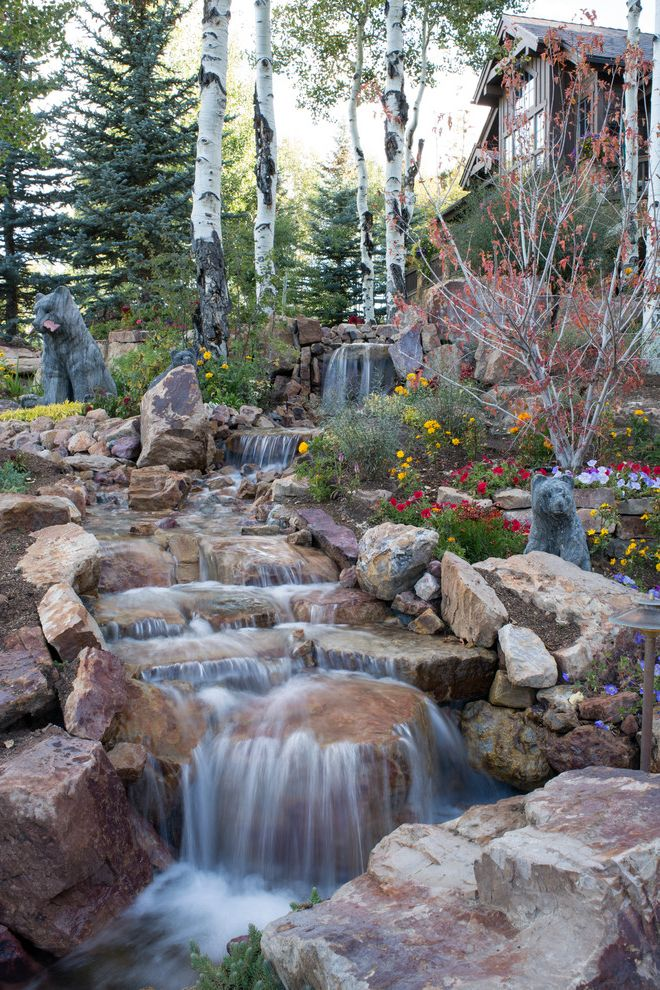 Landscaping Longmont Co   Rustic Landscape Also Beautiful Stonework Boulder Walls Chapel Flowers Large Water Features Logs Manmade Waterfall Ponds Waterfall