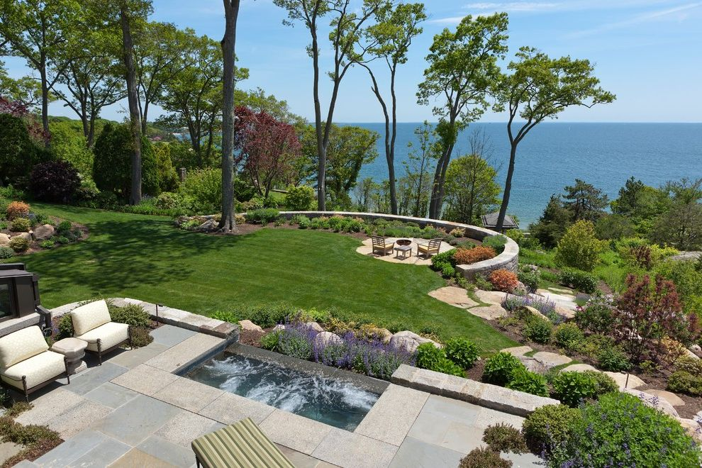 Landscaping Longmont Co   Traditional Landscape Also Boulders Curved Retaining Wall Exteriors Flagstone Landscape Lavender Lawn Metal Outdoor Furniture Ocean View Patio Small Pool Spa Stone Patio Terrace Trees Water Feature Waterfall White Seat Cushions