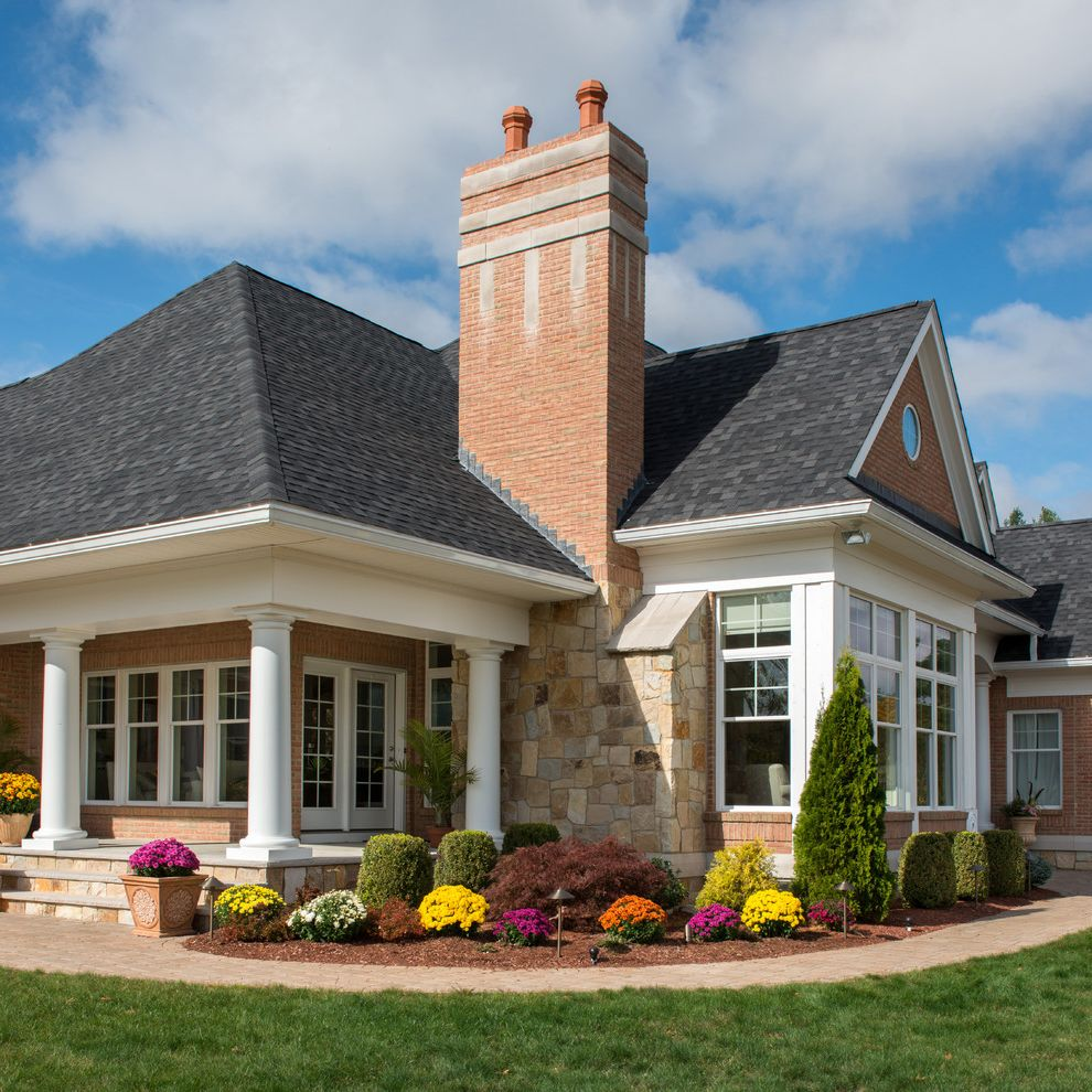 Landscaping Longmont Co   Traditional Landscape  and Brick Chimney Columns Mums Planters Stone and Brick Chimney