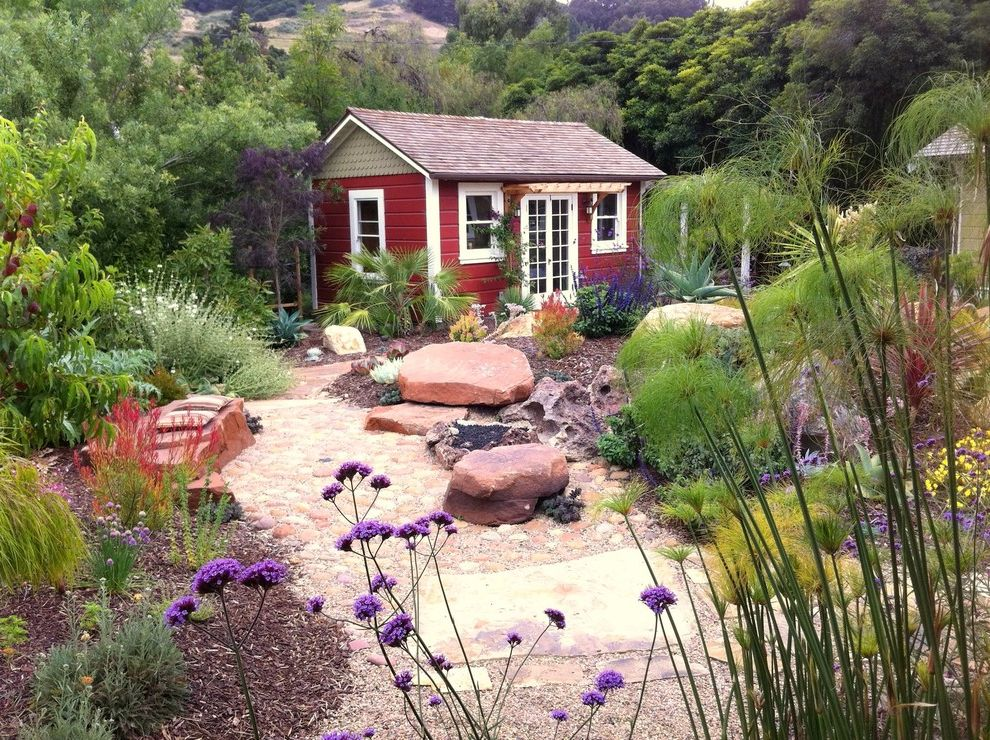 Landscaping Longmont Co with Mediterranean Shed Also Bark Mulch Boulders Flagstones Garden Gravel Landscaping Path Pergola Red Ship Lap Small House Studio Tall Grasses White Trim Wood Chips