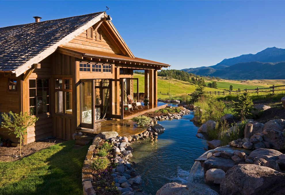 Landscaping Rock Louisville Ky   Rustic Exterior Also Boulders Covered Porch Creek Exterior French Doors Grass Lawn Lodge Rocks Rustic Shake Roof Split Rail Fence Stone Stone Patio Timber Design Water Feature Wood Siding