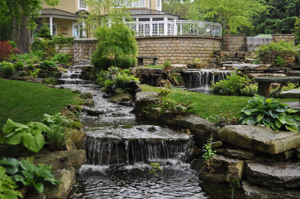 Landscaping Rock Louisville Ky   Traditional Landscape  and Boulders Brick Wall Bushes Grass Koi Lawn Outdoor Pond Pond River Rocks Shrubs Small River Tall Brick Wall Water Feature Water Fountain Water Garden Waterfall White Railing Wrought Iron Railing
