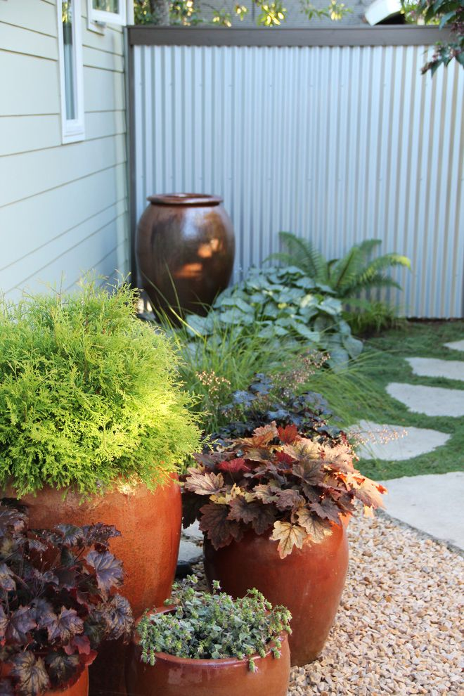 Large Flour Container with Beach Style Landscape Also Bainbridge Island Beach Garden Container Garden Galvanized Metal Fence Gravel Pots Potted Plants Stepping Stones Waterfront Garden