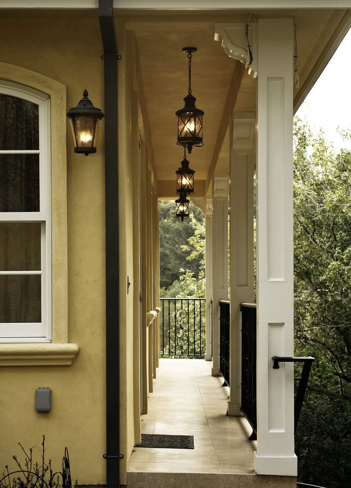 Large Outdoor Hanging Lantern   Traditional Porch Also Arched Window Chandelier Iron Railing Lantern Mediterranean Stucco Tile Yellow Stucco