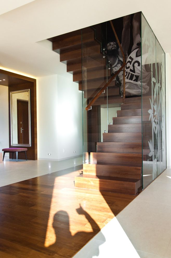 Large Prints for Walls   Modern Staircase Also Accent Lighting Glass Panel Glass Staircase Railing Large Artwork Large Photo Open Staircase with Big Photo Staircase Landing Tile Floor White Walls Wood Bannister Wood Floor Wood Staircase