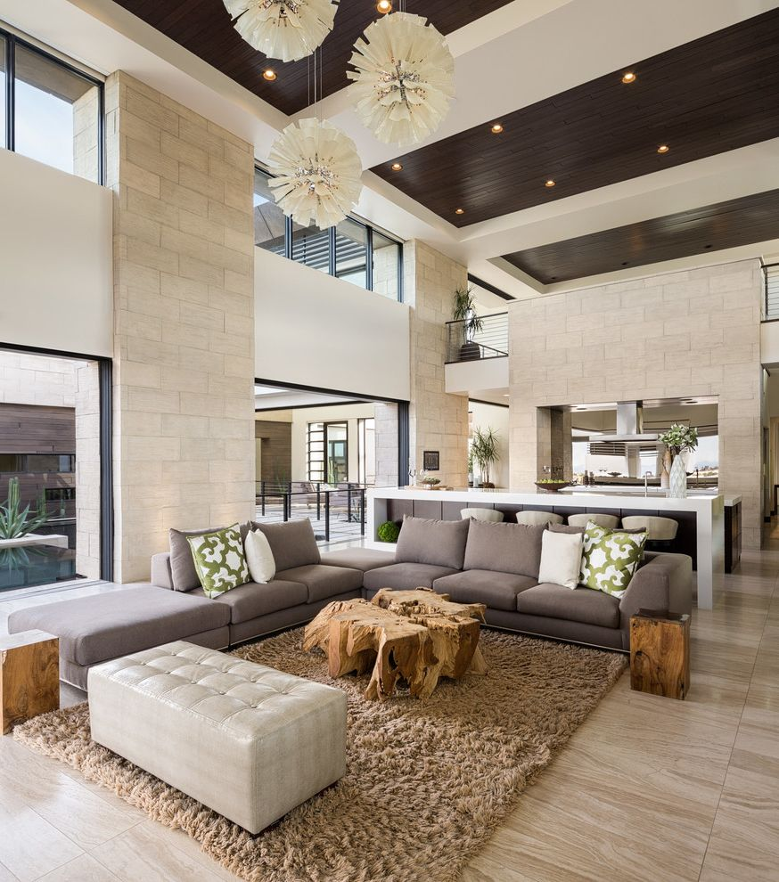 Las Vegas Entertainment Productions with Contemporary Living Room Also Ceiling Panels Clerestory Windows Dark Wood Ceiling Gray Sectional Sofa High Ceilings Pendant Lights Recessed Lighting Tufted Ottoman Waterfall Countertop White Countertop