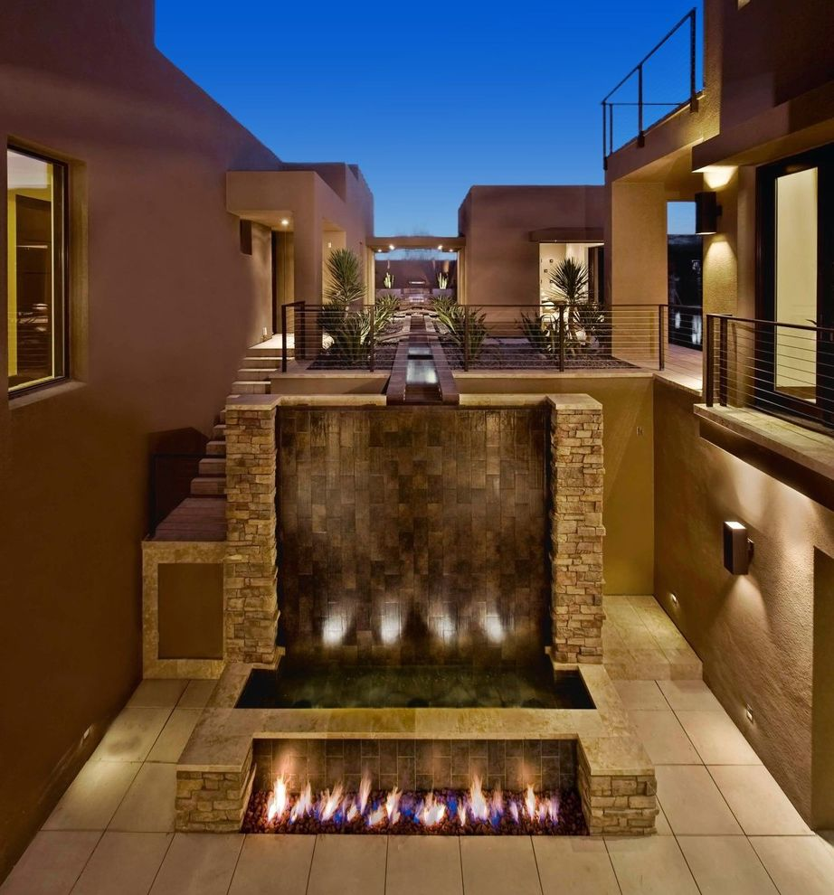 Las Vegas Entertainment Productions with Contemporary Patio  and Beige Walls Dramatic Drought Tolerant Landscape Dusk Fire Feature Gravel Metal Railing Night Lighting Patio Wall Lighting Water Feature Waterfall