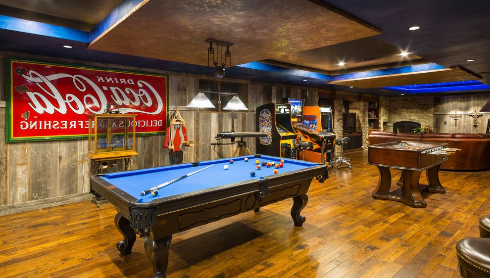 Leawood Theater with Rustic Family Room Also Arcade Games Entertaining Room Game Room Leather Couch Lower Level Media Room Party Room Pool Table Table Soccer Game Tray Ceiling Vintage Coca Cola Sign