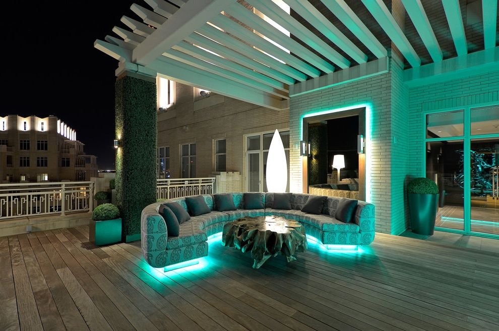 Led Yard Flood Lights with Contemporary Deck and Accent Table Ambient Lighting Curved Sofa Cushions Living Wall Lounge Pergola Potted Plant Railing Sconce Sitting Area Topiary View