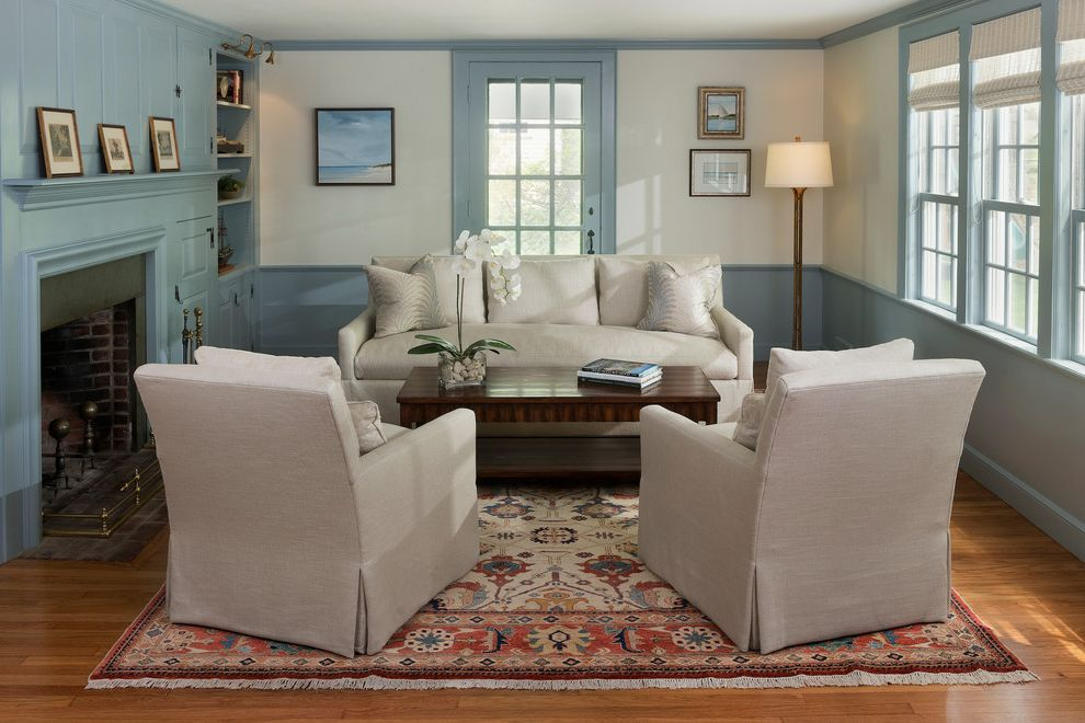 Lee Blum Furniture   Transitional Living Room Also Beach Beach Painting Blue and White Blue Trim Blue Wainscoting Fireplace Millwork Oriental Rug Swivel Chairs Transitional Cape White Sofa Woven Shades