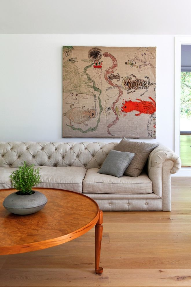 Legendary Upholstery   Contemporary Living Room Also Artwork Chesterfield Sofa Contemporary Houseplant Minimal Modern Neutral Tones Round Wood Coffee Table Scandinavian Sofa White Walls Wood Flooring