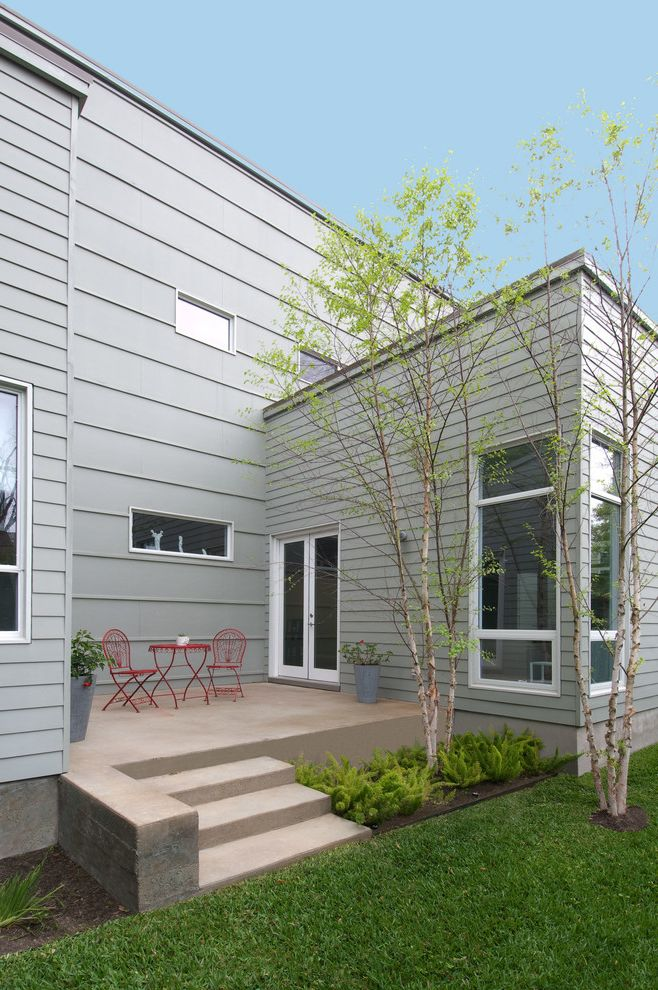 Lennar Homes Houston   Modern Patio Also Concrete Patio Contemporary Landscaping Ferns Lawn Low Maintenance Landscape Modern Landscape Modern Landscaping Outdoor Furniture Panel Siding Red Chairs Small Patio White Trim