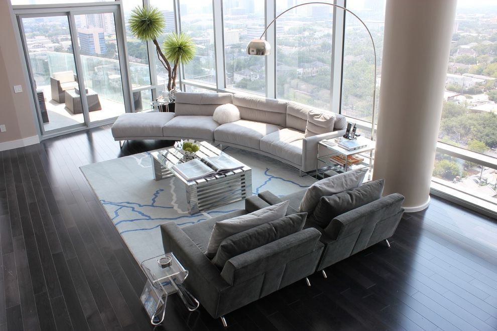 Lennar Homes Houston with Contemporary Living Room  and Arc Lamp Area Rug Clear Furniture Curved Sofa Dark Floor Glass Walls High Ceilings High Rise House Plants Metallic Accents Neutral Colors Open Living Room View