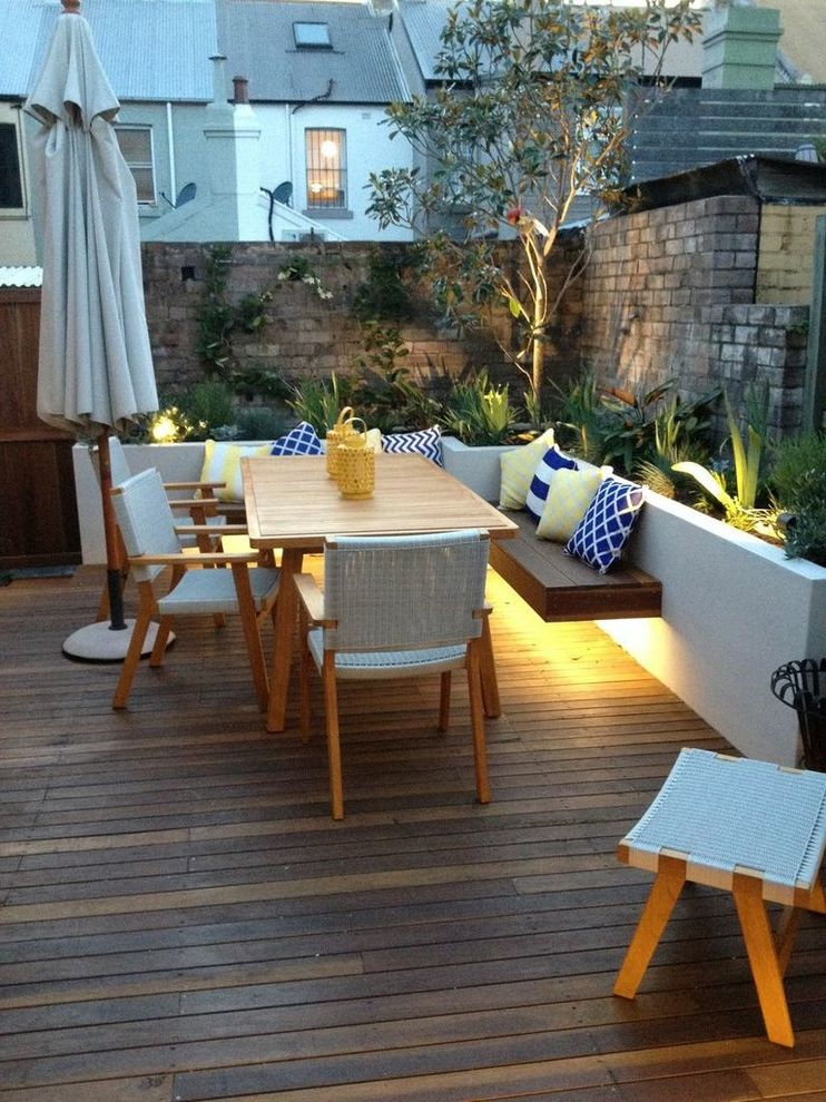 Lettuce Entertain You Restaurants Chicago   Contemporary Deck Also Bench Seating Blue Pillows Cove Lighting Decking Floating Seat Lighting Outdoor Lighting Patio Umbrella Raised Garden Bed Softscapes Wooden Dining Table