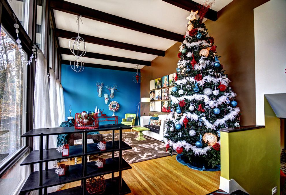 Lifelike Artificial Christmas Trees   Midcentury Living Room  and Area Rug Beams Wood Floor Blue Brown Christmas Colorful Interiors Dark Stained Wood Green Mid Century Modern Photo Gallery Transom Windows Wall Art White Curtain Panels