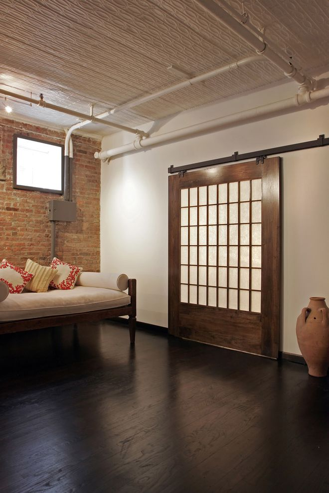 Lifetime Door Company With Industrial Living Room Also Dark Wood Floor  Daybed Door Track Exposed Brick