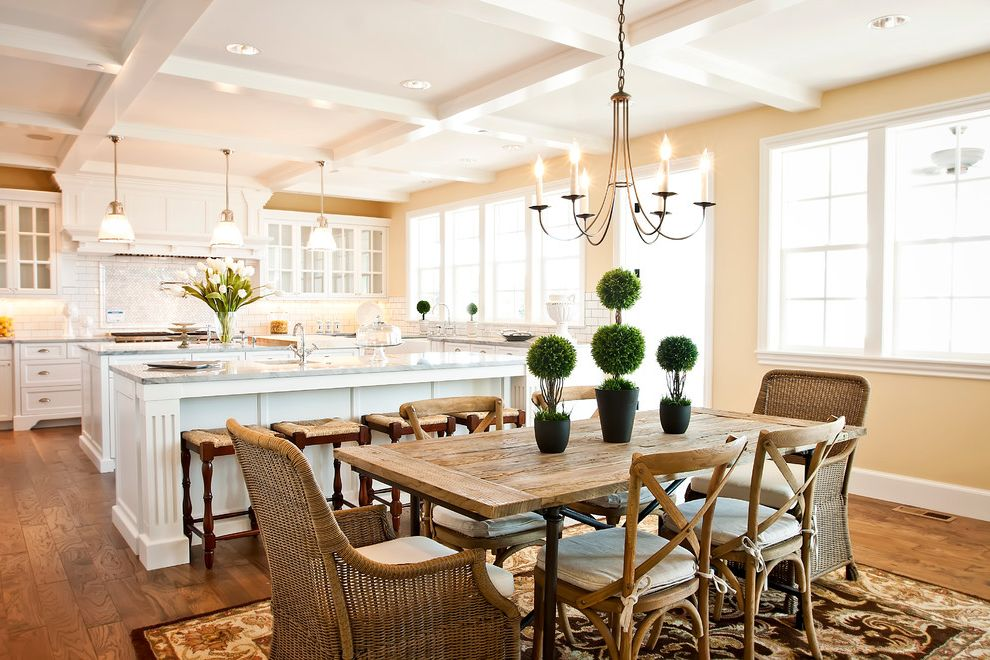 Light Dep Greenhouse   Traditional Dining Room  and Area Rug Chandelier Coffered Ceiling Double Hung Windows Hardwood Floors Light Yellow Wall Muntins Pendant Lights Topiaries White Island Wicker Chairs Wood Dining Table