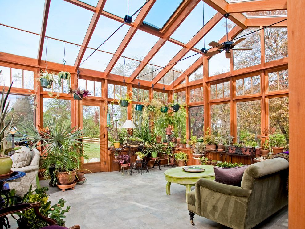 Light Dep Greenhouse   Traditional Porch Also Casters Ceiling Fan Conservatory Gray Tile Floor Green Coffee Table Green Sofa Green Velvet Sofa Greenhouse Roof Hanging Plants Potted Plants Round Coffee Table Terracotta Pots