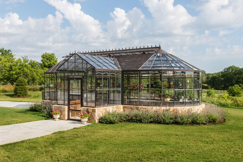 Light Dep Greenhouse with Traditional Shed  and Backyard Conservatory Glass Greenhouse Landscaping Lawn Path Potted Plants Spires Stonework Teak Bench Urns Walkway