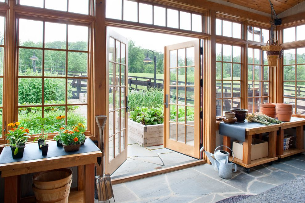 Light Dep Greenhouse with Traditional Shed  and Benches Flagstone Floor French Doors Garden Potting Room Raised Garden Beds Terra Cotta Transom Windows Watering Cans Work Tables