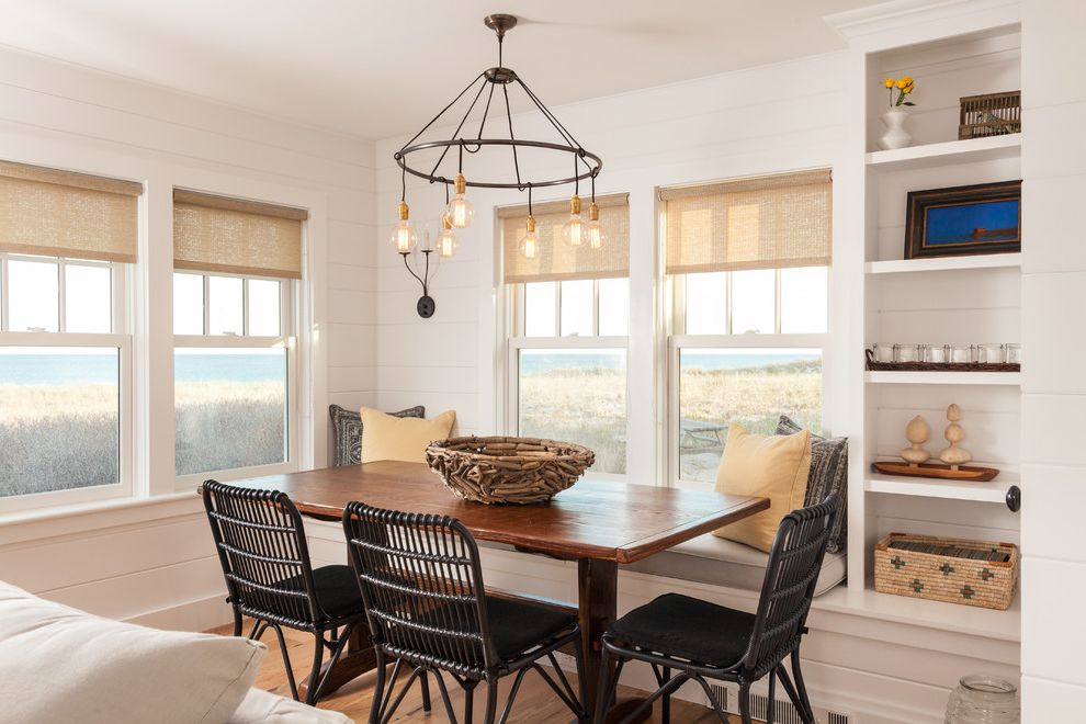 Linen Roller Shades with Beach Style Dining Room  and Beach Cottage Black Dining Chair Built in Bench Builtin Shelves Chandelier Coastal Cottage Driftwood Bowl White Wall Paneling