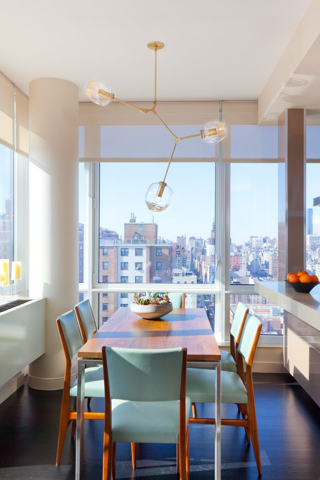 Linen Roller Shades with Contemporary Dining Room  and Centerpiece Columns Dark Floor High Rise Modern Light Fixture Radiator Roller Blinds Turquoise Window Shades Wood Dining Table Wood Flooring