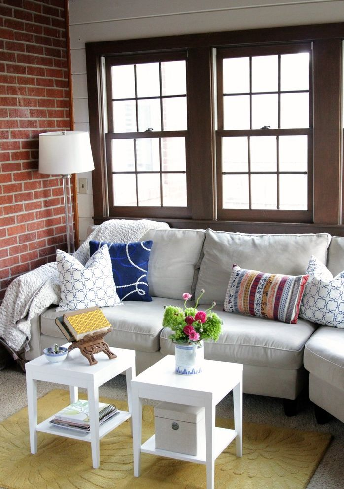 Living Spaces Sofa Table with Eclectic Living Room  and Accent Tables Area Rug Book Stand Brick Double Hung Windows Floor Lamp Graphic Prints Pillows Sofa Throw Yellow