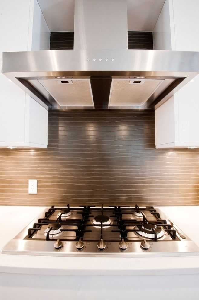 Livingstone Solid Surface with Contemporary Kitchen  and Concrete Concrete Backsplash Concrete with Pattern Concrete with Texture Oven Hood Range White Cabinets White Countertop