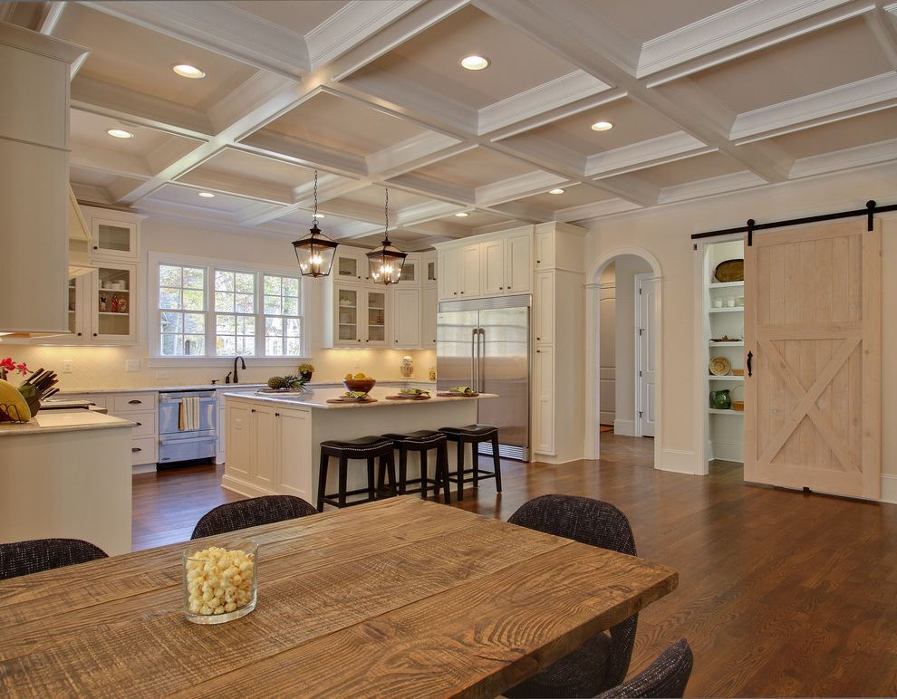 Llc in Washington State with Traditional Kitchen Also Arched Doorway Barn Door Ceiling Lights Coffered Ceiling Counter Stools Dining Table Kitchen Island Pantry Pendant Lights Wood Floors Wood Table