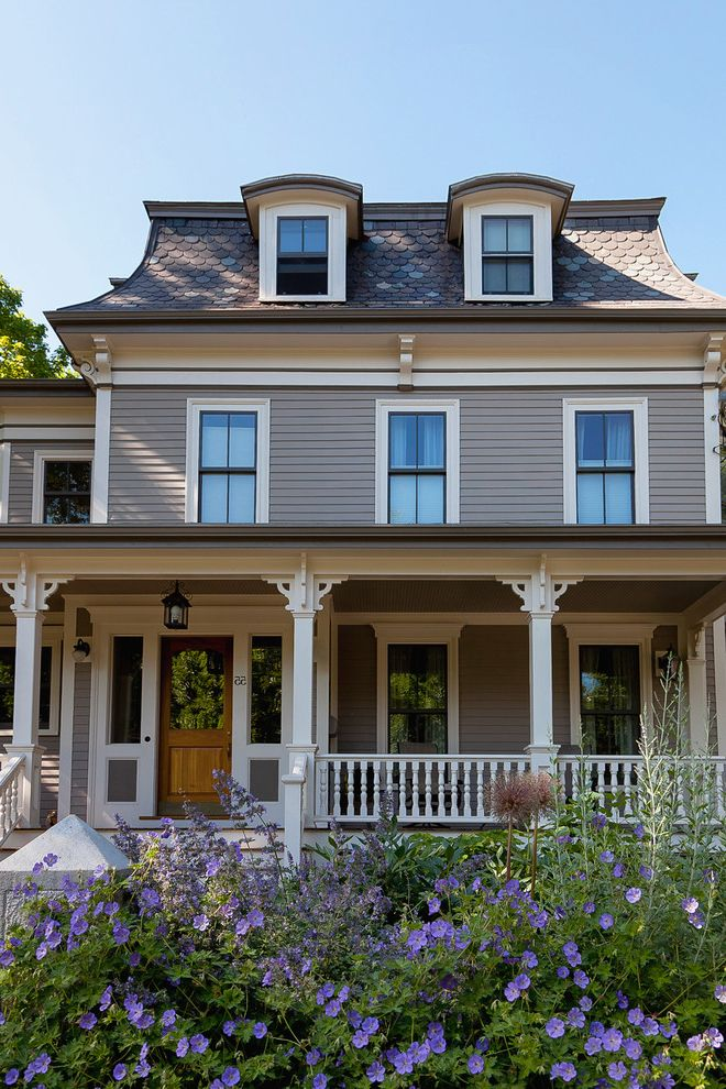 Llc in Washington State with Victorian Exterior Also Corbels Curb Appeal Dormer Front Porch Lantern Mansard Roof New England Picket Railing Purple Flowers Shingles Shutters Side Lites Siding Slate Victorian Wood Door