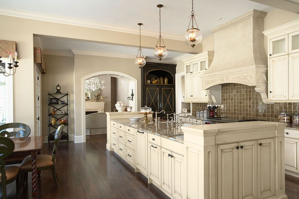 Local Citation Building with Traditional Kitchen  and Arched Doorway Chandelier Dark Stained Wood Floor Dining Table Etagere Valance Frame and Panel Woodwork Hood Kitchen Island Kitchen View of Island From Sitting Area Lantern Tile Mosaic