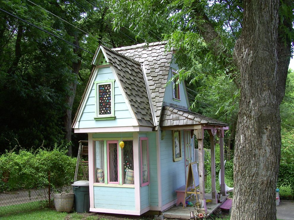 Lockwood Storage with Farmhouse Landscape Also Backyard Playhouse Diamond Window Panes Front Porch Girls Playhouse Kids House Pale Green Siding Pink Trim Steep Pitched Roof Two Story Playhouse Weathered Shingles Wood Shingle Roof