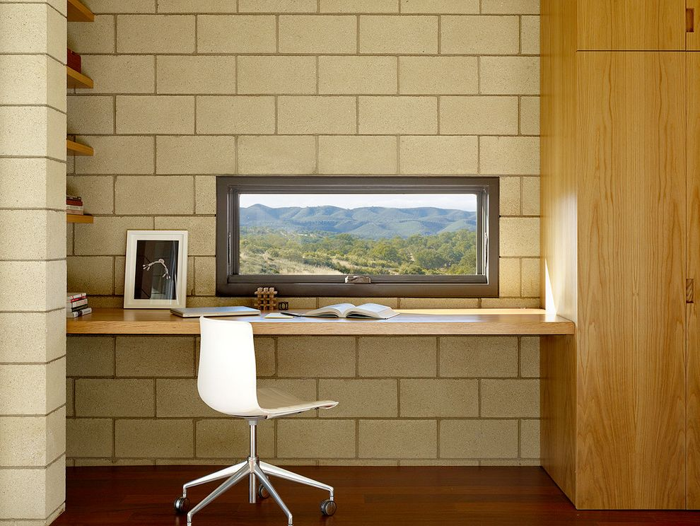 Lockwood Storage with Modern Home Office  and Built in Desk Built in Storage Casement Window Casters Concrete Block Dark Wood Floor Floating Desk Ipe Ipe Flooring Mountain View Shelves Small Desk Small Window White Task Chair Workspace