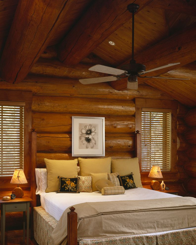 Log Cabin Stain with Rustic Bedroom  and Artwork Bed Pillows Bedside Table Cabin Ceiling Fan Exposed Beams Log Cabin Nightstand Rustic Sloped Ceiling Vaulted Ceiling Wall Art Wall Decor Window Treatments Wood Ceiling Wood Walls