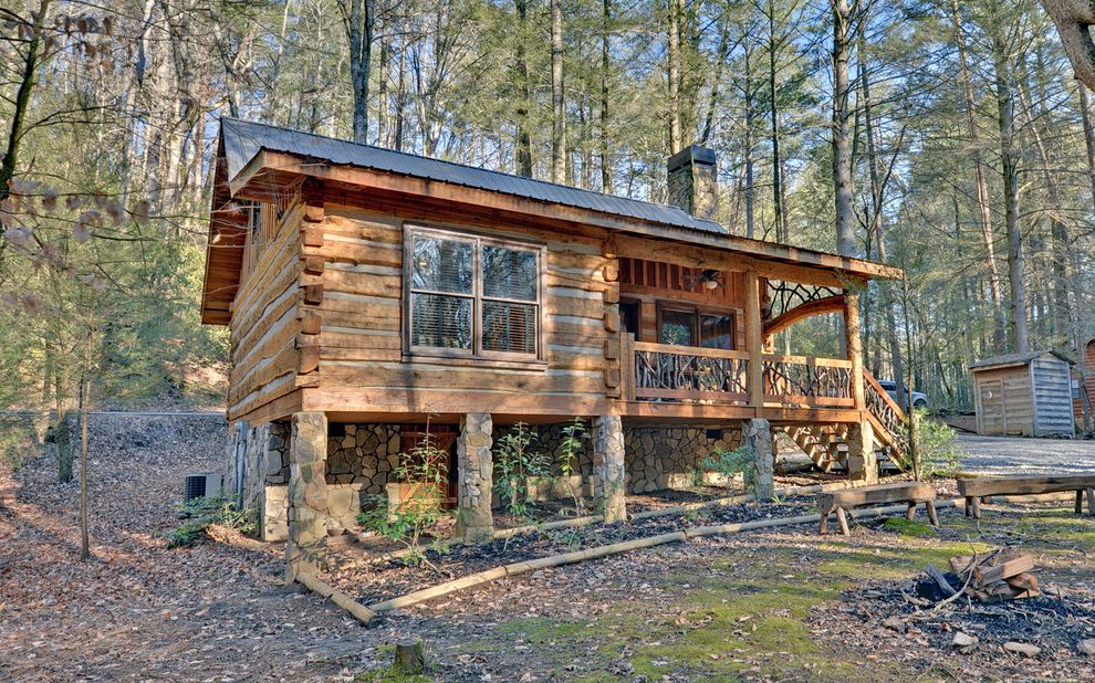 Log Cabin Stain with Rustic Exterior Also Covered Porch Log Cabin Log Posts Log Walls Metal Roof Out House Porch Columns Porch Supports Rustic Cabin Rustic Railing Salt Box Roof Stone Chimney Stone Pillars