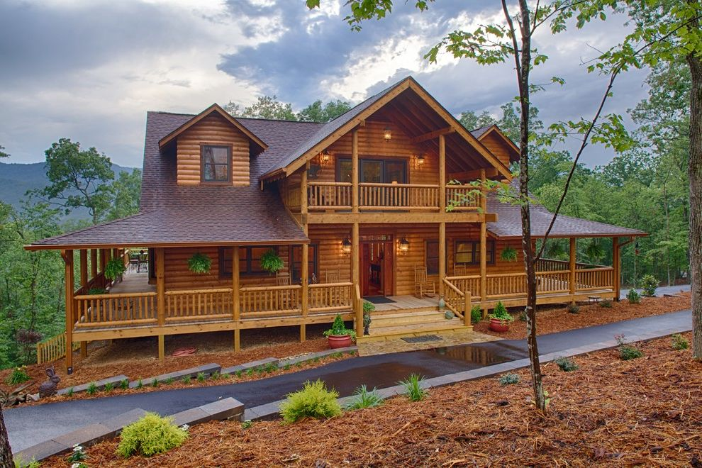Log Home Builders in Ga with Rustic Exterior  and Balcony Dormer Windows Dormers Gable Gable Porch Lodge Log Cabin Log Home Mountain Home Porch Wood Wrap Around Porch