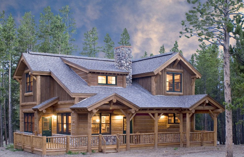 Log Siding for Houses with Rustic Exterior  and Cabin Covered Entry Covered Porch Front Porch Green Window Trim Log Rail Mountain Chalet Railing Shed Dormer Shingle Roof Stone Chimney Timber Trees Two Story Windows Wraparound Porch