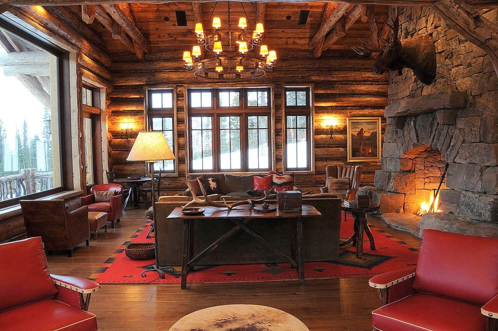 Log Truck Games with Rustic Living Room Also Chandelier Chinking Dining Room Large Fireplace Lodge Log Home Moose Head Red Accents Red Leather Round Logs Rustic Stonework Vintage Wood Floor
