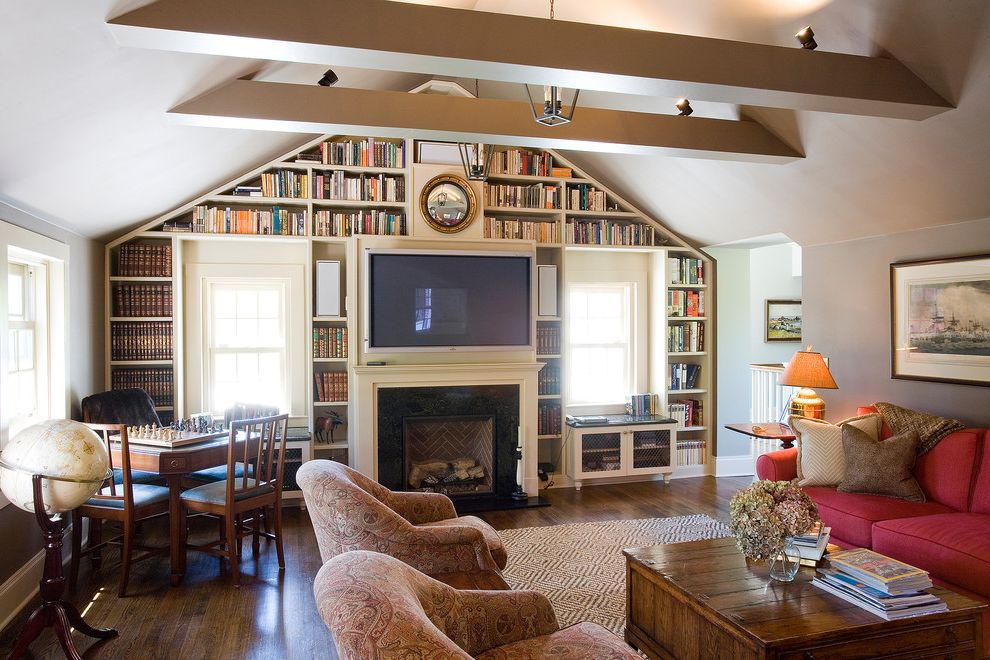 Log Truck Games with Traditional Family Room Also Armchairs Beams Bookshelves Federalist Mirror Game Table Globe Gold Mirror Lantern Mantel Paisley Red Sofa Round Mirror Tv Over Fireplace Vaulted Ceiling Wall of Books Window Seats