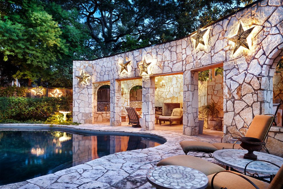 Lone Star Auctions   Eclectic Patio  and Beige Dark Swimming Pool Lounge Chairs Mosaic Tile Tabletops Outdoor Seating Patio Furniture Star Art Star Lights Stone Patio Stone Walls Tan Stones Wall Lighting Wall Stars