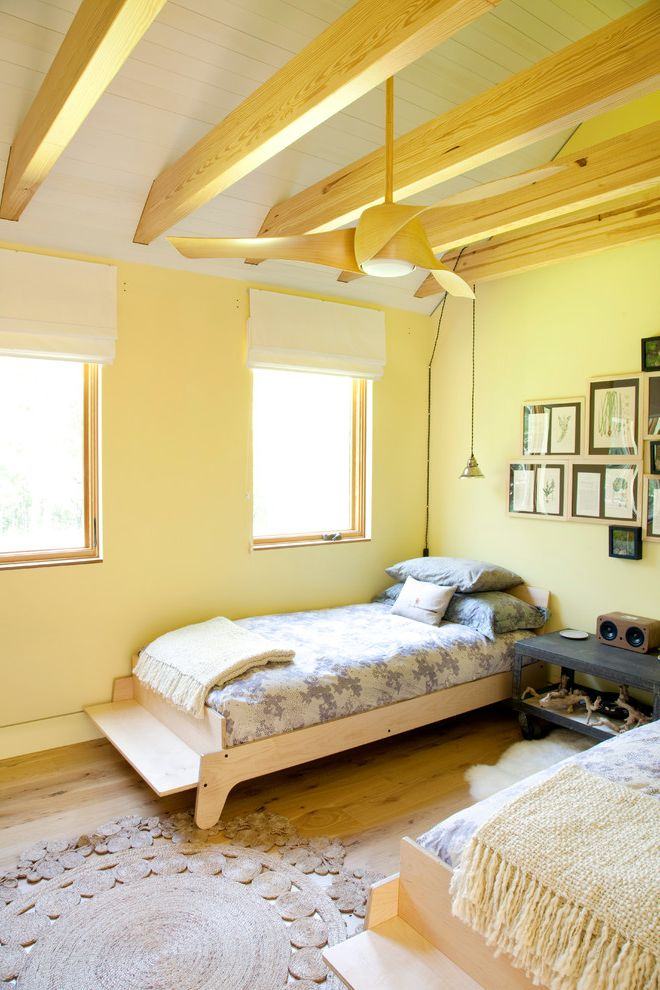 Lowes Amarillo   Contemporary Bedroom  and Beams Blonde Wood Ceiling Fan Ceiling Fan Country Driftwood Fringed Throw Gray Guest Room Industrial Modern Natural Fiber Rug Planks Round Rug Rustic Twin Beds White Roman Shades Wood Woven Rug Yellow Walls