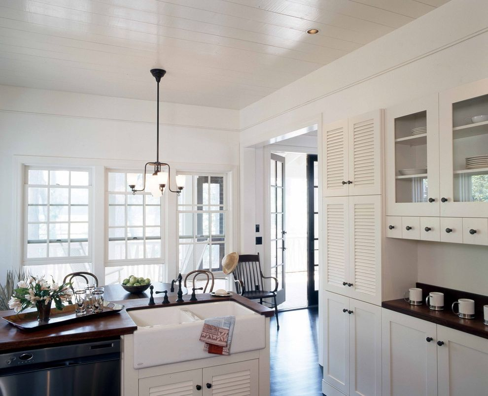 Lowes Apron with Shabby Chic Style Kitchen and Apron Sink Country Kitchen Double Hung Windows Farm House Farmhouse Sink Glass Front Cabinets Louvered Doors Low Country Shaker Style White Kitchen Wood Countertops
