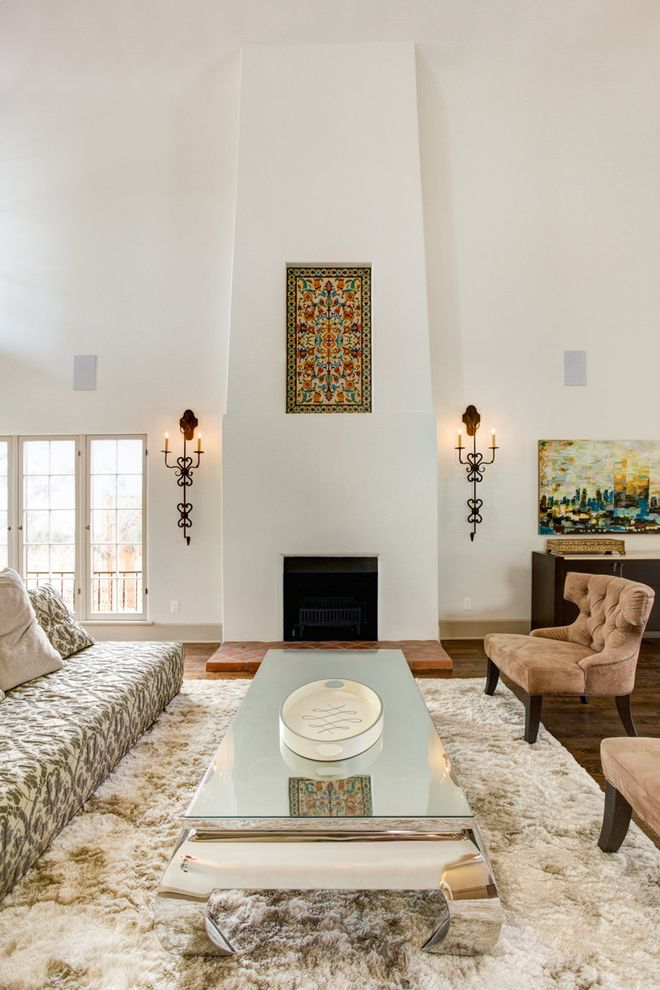 Lowes Arnold Mo   Mediterranean Living Room Also Beige Area Rug Brown Armchair Mirrored Coffee Table Patterned Sofa Wall Art Wall Sconces