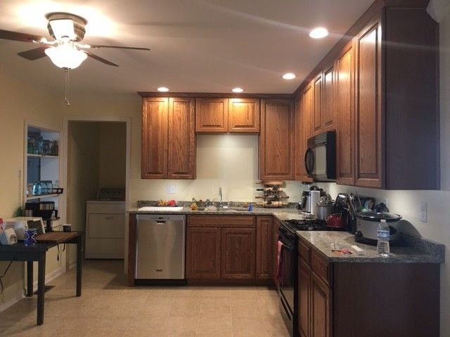 Lowes Beckley Wv with Traditional Spaces Also Crown Molding Drywall Kitchen Appliances Oak Cabinets Recessed Lighting Under Cabinet Lighting Vinyl Flooring